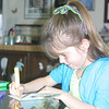 Making a birthday card for her friend Natalie